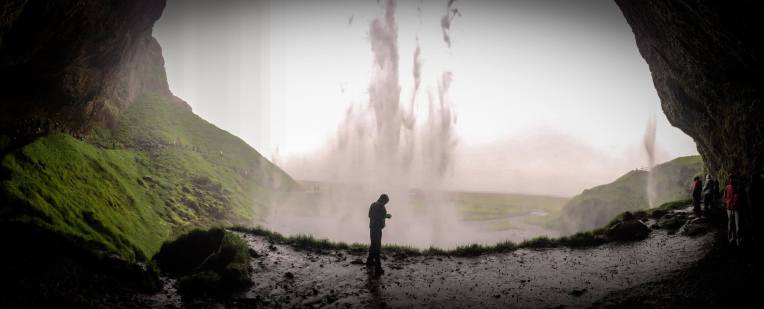 walking behind Seljalandsfoss waterfall