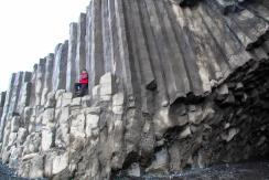 Basalt columns at the Reynisfjara shore- black sand beach of South Iceland